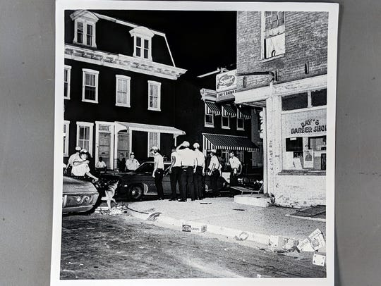 Row homes in an area of rioting, with York police and