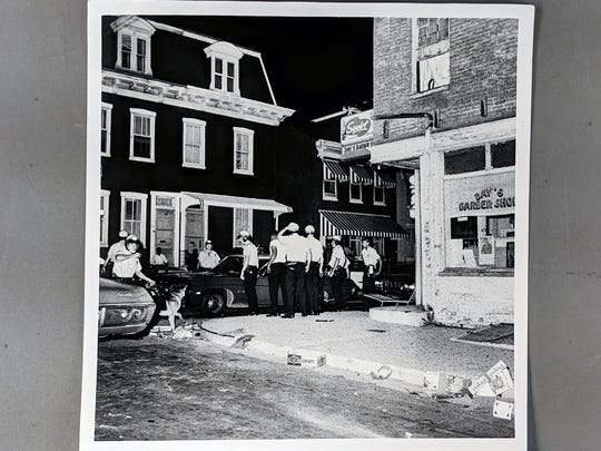 Row homes in an area of rioting, with York police and bystanders in July 1968.