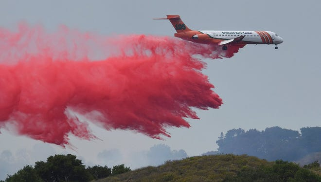 A plane filled with fire retardant makes a drop on the Cruces Fire in Santa Barbara County Wednesday afternoon.