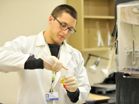 Lions running back Zach Zenner conducts a test in the Hypertension and Vascular Research Department at Henry Ford Hospital in Detroit on Apr. 20, 2016.