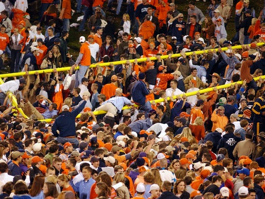 Clemson fans ride the goal post up the hill at Death