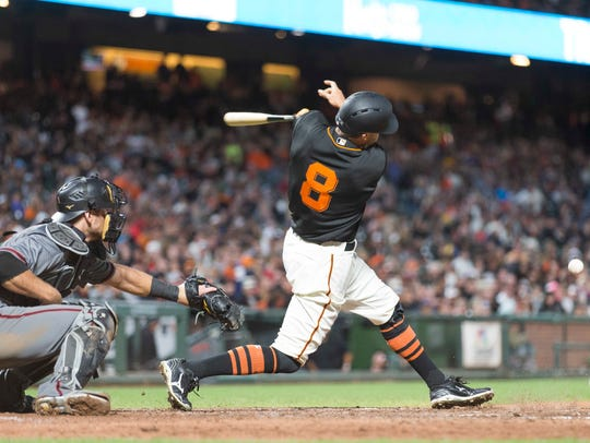 Giants right fielder Hunter Pence (8) hits a two-run