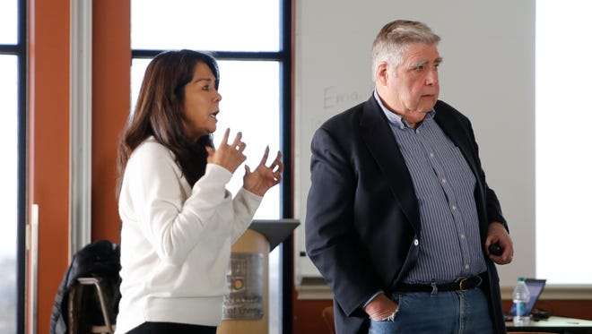 Eunice Tso, owner and president of ETD Inc., left, and John Stigmon, president and CEO of the Economic Collaborative of Northern Arizona, share information on Tuesday from a study that examines economic development possibilities for the Navajo Nation.