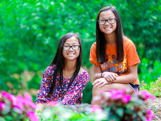 Audrey Doering, right, and her twin sister Gracie Rainsberry pose for a photo Wednesday, July 25, 2018, at the Doerings' house in Wausau, Wis.