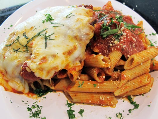 Chicken parm served with pasta is the most popular