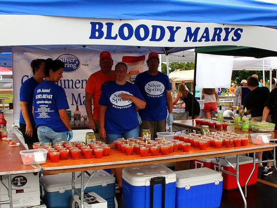 One of the most popular booths manned by Supply Chain Manager Jeff Holden and his crew of volunteers prepare non-alcoholic bloody marys for the Mustard Day crowds.