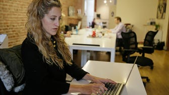 Ashley Breinlinger, a senior vice president at BOCA Communications, at her office desk in San Francisco. Breinlinger describes this flu season as the ugliest she's seen in 10 years, in terms of how sick people are getting.