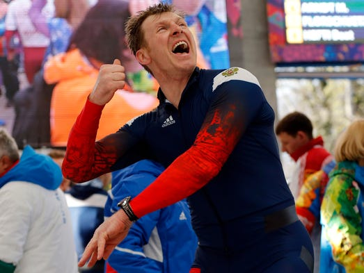 RUS-1 pilot Alexander Zubkov reacts after heat four of men's four-man bobsled