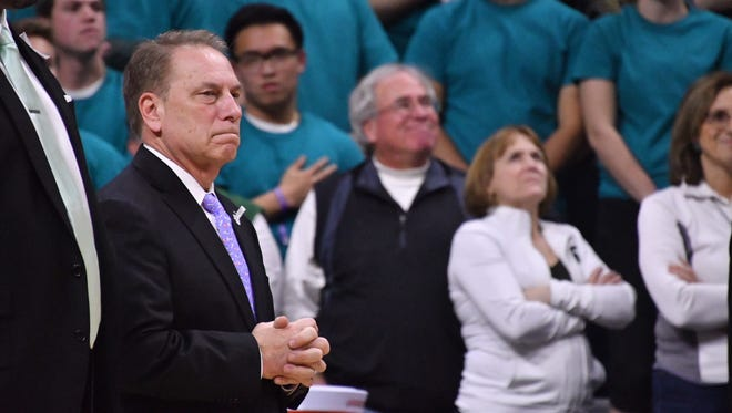 Michigan State basketball coach Tom Izzo watches the Spartans warm up before Friday night's game against Wisconsin.