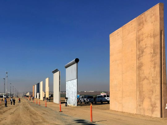 This Oct. 26, 2017 file photo shows prototypes of border walls in San Diego. The Trump administration has proposed spending $18 billion over 10 years to significantly extend the border wall with Mexico.