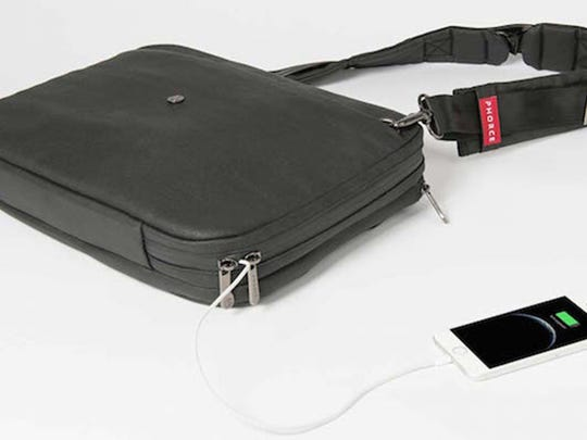 The Phorce Freedom over-the-shoulder messenger smart bag holds everything you would expect but also charges a pair of USB devices inside the bag.
