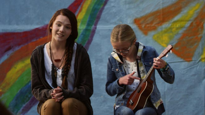 Lane (left, Paris Warner) and Phoebe (Mila Smith) perform a song during camp.
