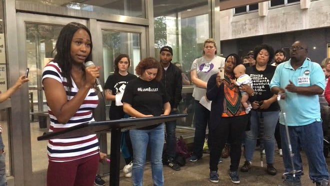 Aaron Bailey's daughter, Erica, left, thanks a crowd for their support during rally outside the City-County Building in Downtown Indianapolis, Friday, May 18, 2018. The group was protesting a decision by a police merit board's decision not to fire the Indianapolis police officers who fatally shot unarmed motorist Aaron Bailey.
