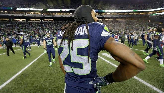 Seattle Seahawks cornerback Richard Sherman stands on the field after Saturday's 34-31 loss to Arizona on a last-second field goal.