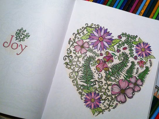 This completed page is from Lydia Hess' adult coloring