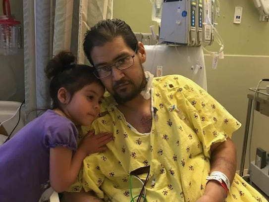 Adrian Martinez and his daughter, Ava.
