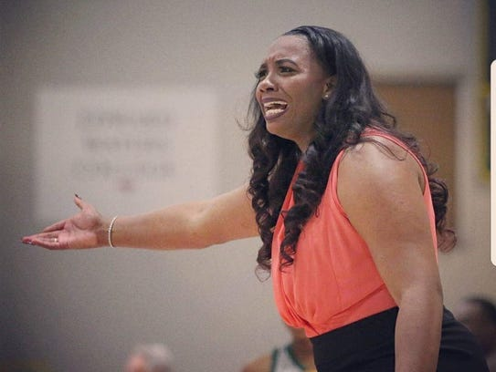 Paul Quinn coach Erica Henry received the USCAA National