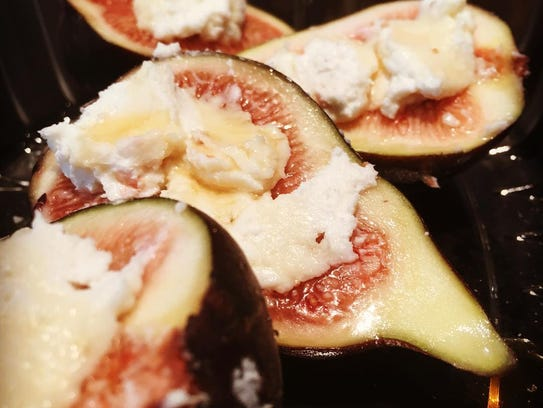 Stuffed figs are topped with local honey by Valente's