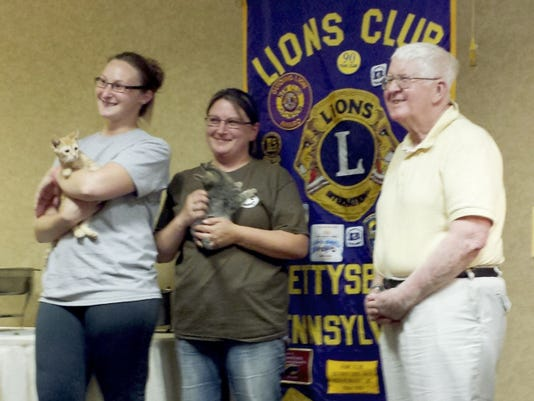 Gettysburg Lion Paul Deignan, right, introduces Stephanie Baum and her assistant, Sabrina Swann, to the Gettysburg Lions Club meeting.