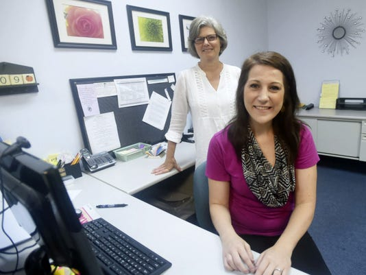 Assistant Center Director, Ruth Schiler, left, and Center Director Diane Haupt, of PMI Pregnancy Resource Center, talk recently about the services at their location at 220 S. Potomac St. in Waynesboro.