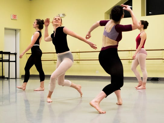 Eva Edinger, second from left, rehearses for a perfromance