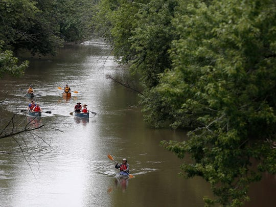 Participants make their way down Beaver Creek in Johnston Saturday, Aug. 29, 2015 during a river canoe outing put on by Des Moines Parks and Recreation.