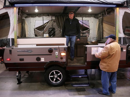 Kevin England, left, 45, of Carleton, MI, and his father in-law Glen Amix, 70, of Rose City, MI, shop for a tent trailers during the 50th Annual Detroit Camper and RV Show at Suburban Collection Showplace on Wednesday, February 10, 2016, in Novi, MI. More than 275 RVs and 50 Brands are on displayed, ranging in price from $7,000 to more than $400,000.