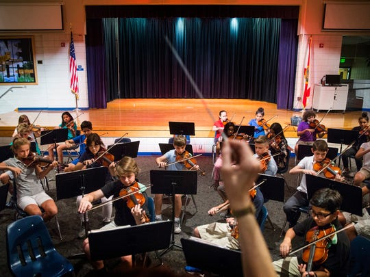 The beginning orchestra students at Pine Ridge Middle School practice on Monday, May 1, 2017, before their spring concert performance Wednesday. Music teacher Nanette Grant used a Champions for Learning grant to bring New York composer Lorie Gruneisen to the school and compose a piece for each of the school's three string classes to play during the performance.