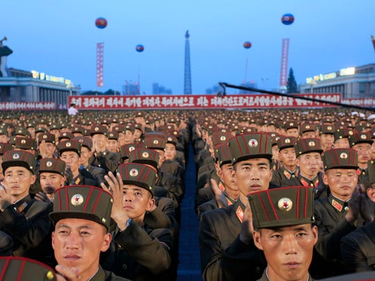 In this Thursday, July 6, 2017, file photo, soldiers gather in Kim Il Sung Square in Pyongyang, North Korea, to celebrate the test launch of North Korea's first intercontinental ballistic missile two days earlier. Threatening to fire a volley of missiles toward a major U.S. military hub _ and the home to 160,000 American civilians _ may seem like a pretty bad move for a country that is seriously outgunned and has an awful lot to lose. But pushing the envelope, or just threatening to do so, is what North Korea does best. (AP Photo/Jon Chol Jin, File)