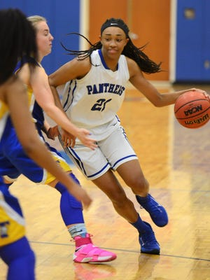 Dee Lampkin of Heritage drives around the Titusville defense during Tuesday's game.