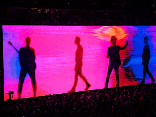 Images of the band are projected on a screen as U2 performs at the Wells Fargo Center Wednesday, June 13, 2018 in Philadelphia, Pa.