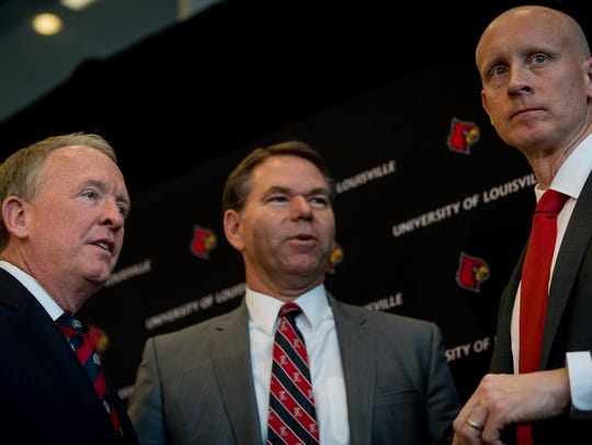 Chris Mack (right) stands with athletic director Vince Tyra (center) and Greg Postel, U of L's interim president at the time, at Mack's introductory press conference on March 28, 2018.