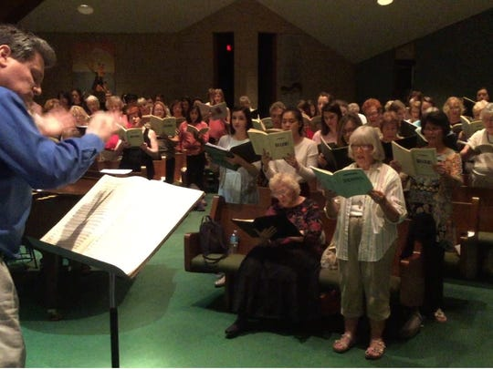 "In this file photo, Gulf Coast Symphony Director Andrew Kurtz leads combined choruses through a ""German Requiem"" rehearsal."