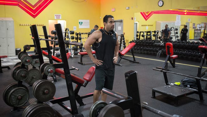 Andrew Guerra catches his breath in the middle of a workout at Primetime Fitness.