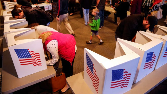 Voters cast ballots at the Robert Mickle Neighborhood center in sherman hill Tuesday, Nov. 8, 2016,