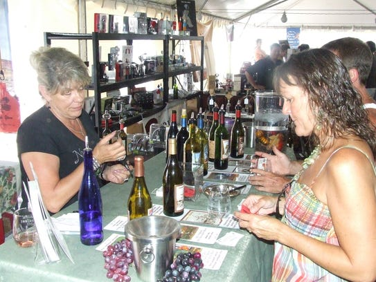 Event goers check out a selection of Arizona wines