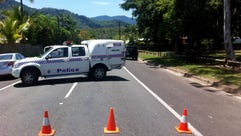 A police car blocks a street at an address in Manoora