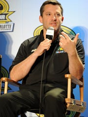 CHARLOTTE, NC - JANUARY 27:  Tony Stewart, driver of the #14 Bass Pro Shops Chevrolet, speaks with the media during NASCAR Sprint Media Tour at Charlotte Convention Center on January 27, 2014 in Charlotte, North Carolina.  (Photo by Jared C. Tilton/Getty Images)