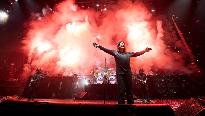 Black Sabbath members, from left, Geezer Butler, Ozzy Osbourne and Tony Iommi are seen during a concert performance earlier this year.