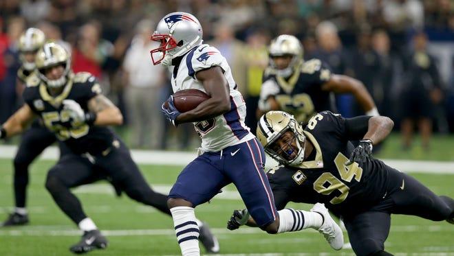 Sep 17, 2017; New Orleans, LA, USA; New England Patriots wide receiver Phillip Dorsett (13) runs past New Orleans Saints defensive end Cameron Jordan (94) in the second quarter at the Mercedes-Benz Superdome. Mandatory Credit: Chuck Cook-USA TODAY Sports