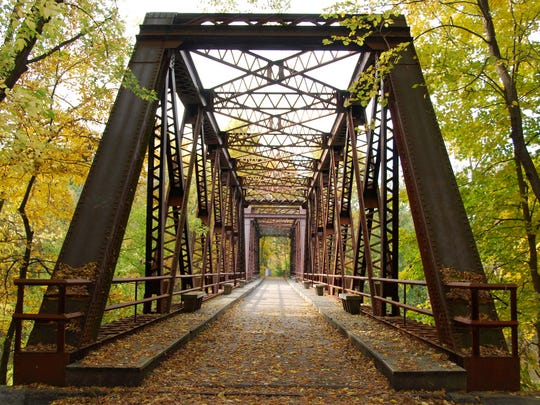 A railroad bridge carries the Wallkill Valley Rail Trail over the Wallkill River in New Paltz.