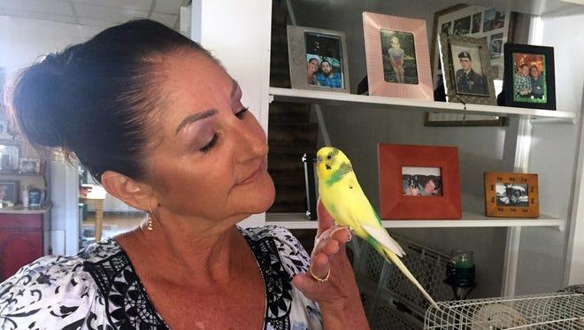 TinaPrestopine with her beloved parakeet Bert.