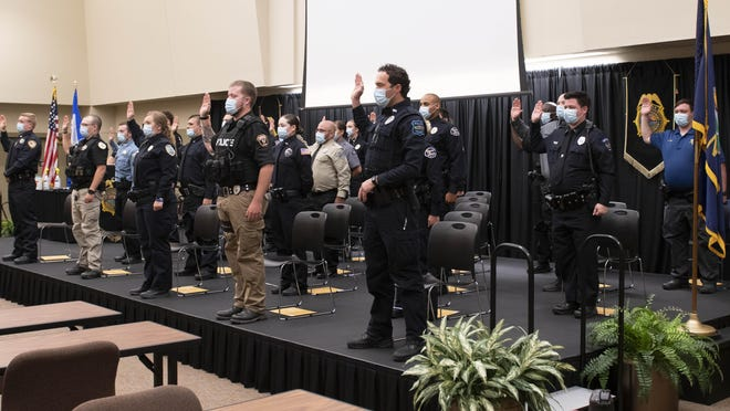 The 264th Basic Training Class, observing social distancing, recite the Code of Ethics affirmation in front of KLETC faculty and staff during its graduation ceremony on June 4 in KLETC's Integrity Auditorium.