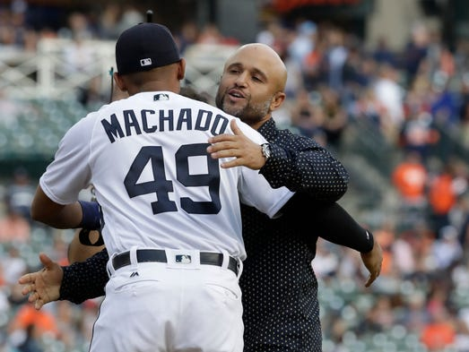 Former Tiger Placido Polanco is greeted by Dixon Machado