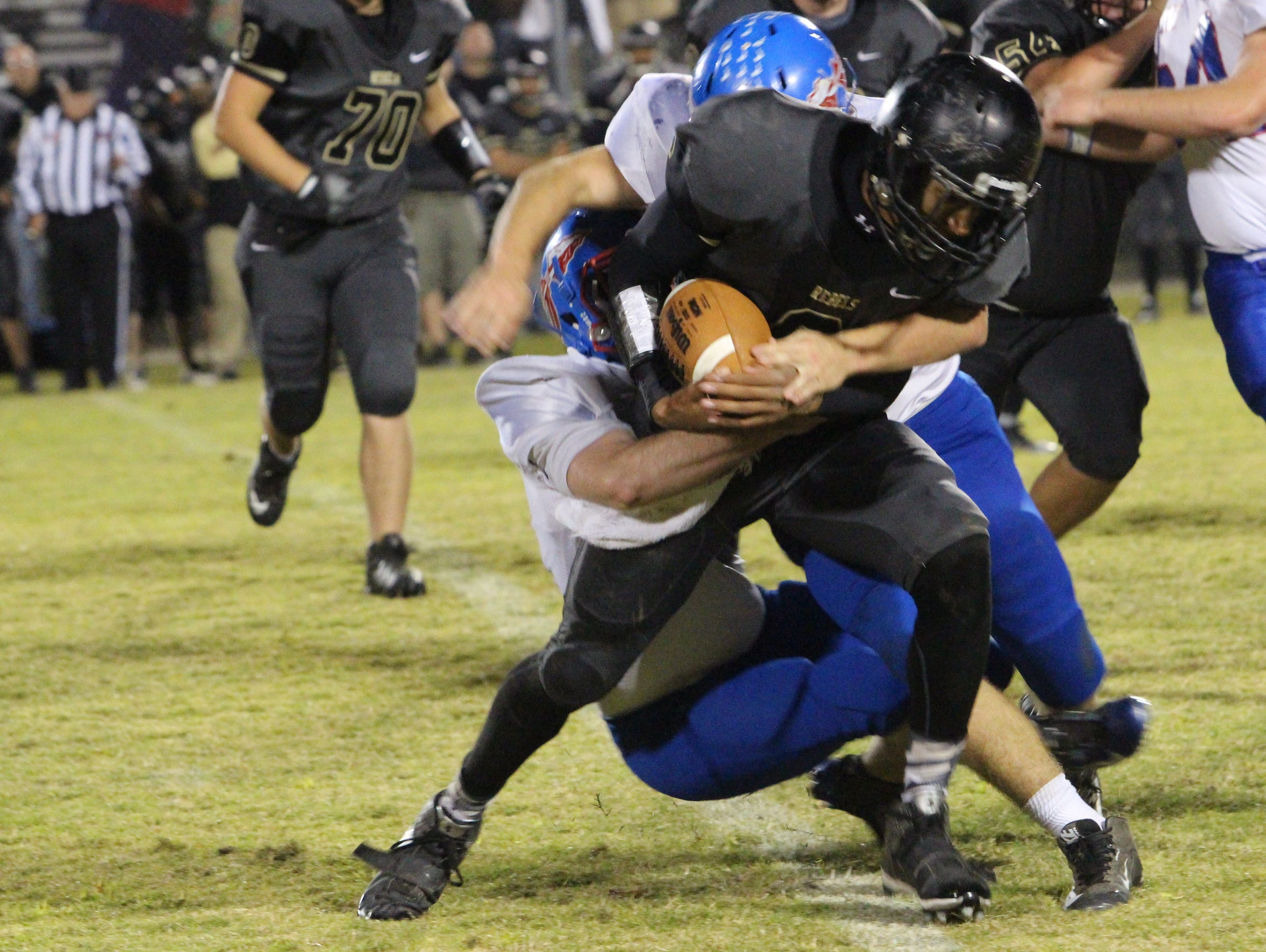 Stewart County's Brandon Ford tries to escape the tackle