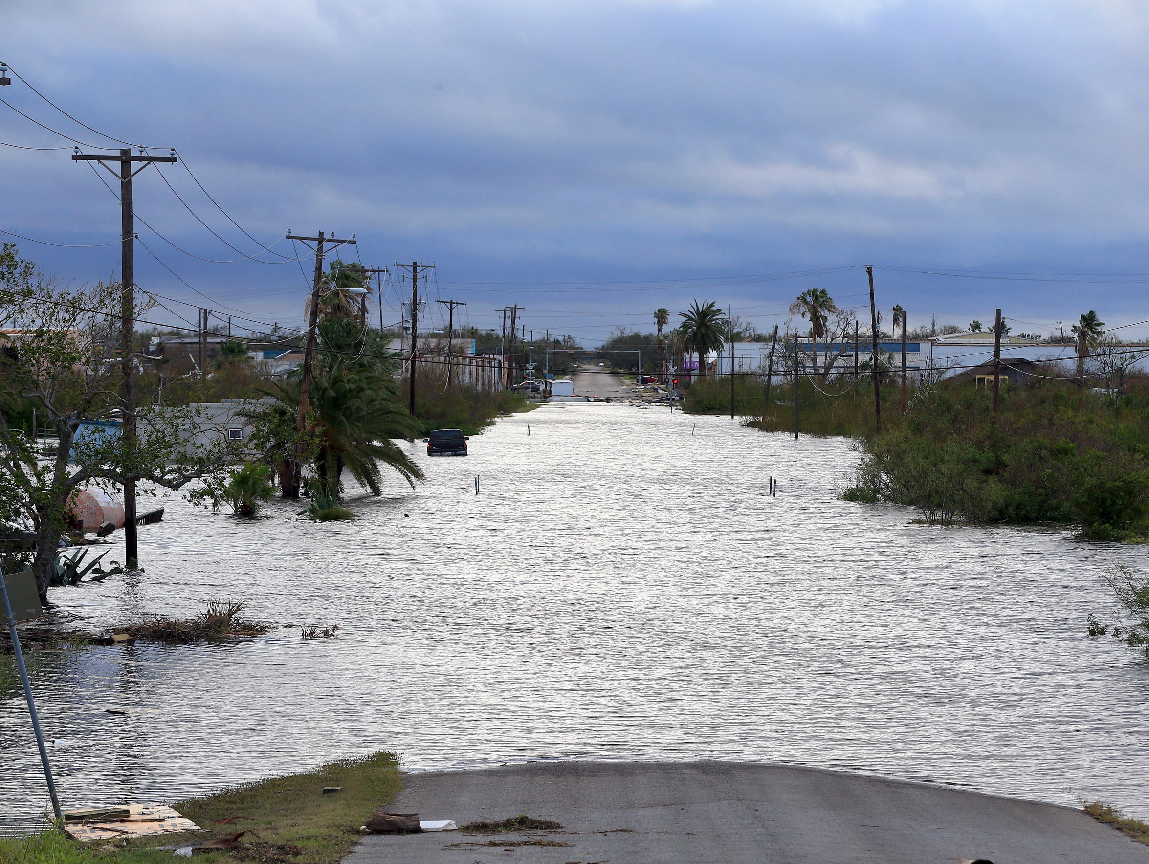 Hours after Hurricane Harvey made landfall, a road in Aransas Pass remains submerged in this Aug. 26, 2017, file photo. Aransas Pass was among Texas Gulf Coast cities that suffered severe flood damage in the storm.