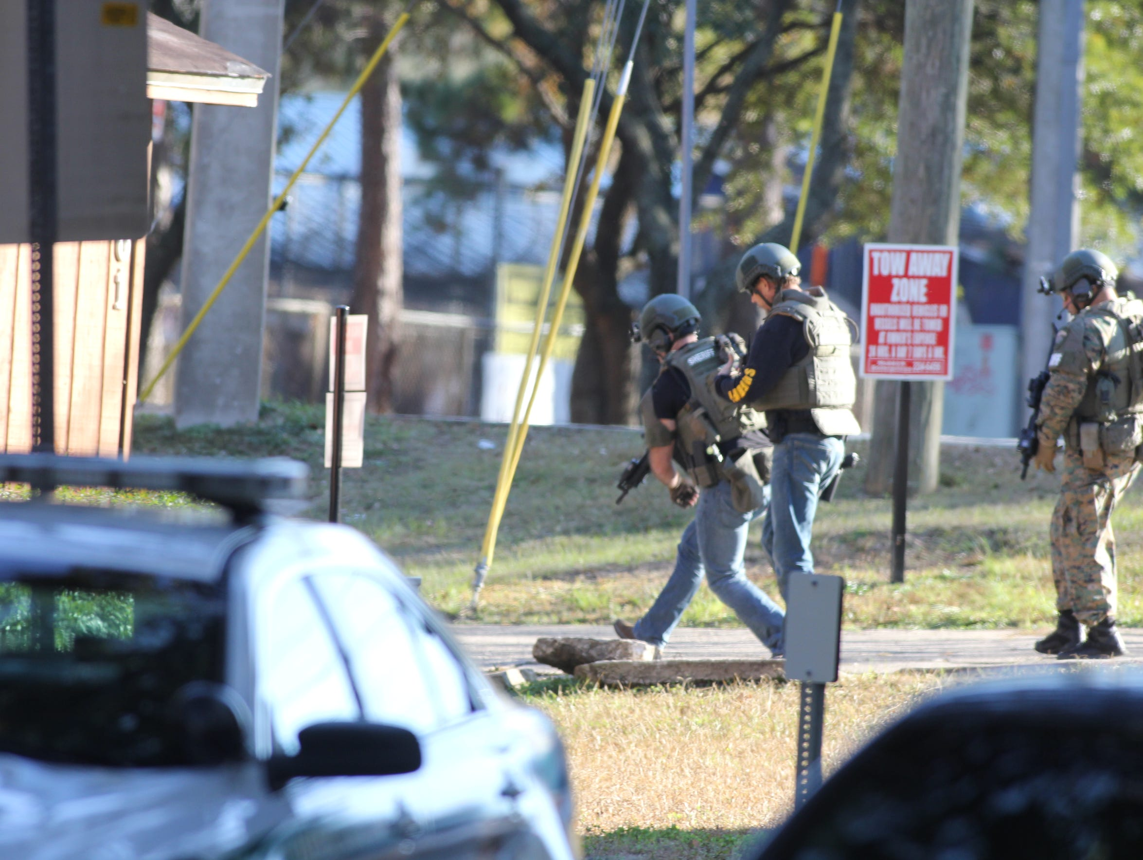 Leon County Sheriff's Office SWAT Team members move