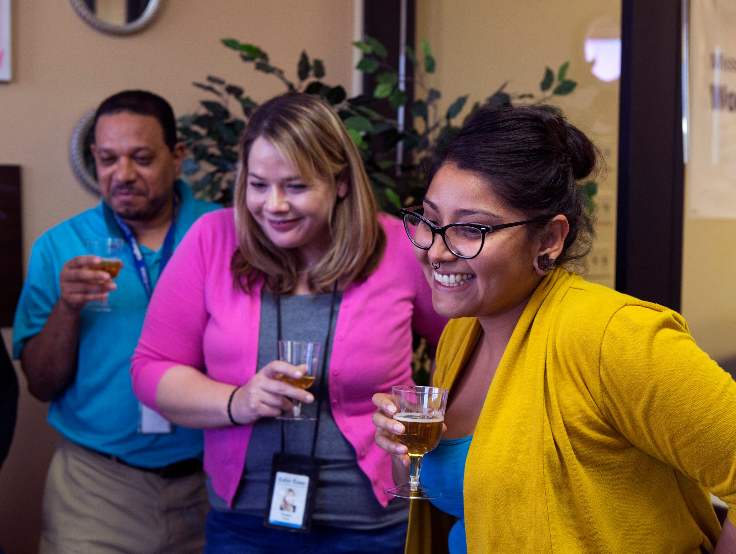 Caller-Times Lead Coach Chris Ramirez (from left), and reporters Kirsten Crow and Beatriz Alvarado prepare for a celebratory toast during a video conference call with The Arizona Republic and other USA Today Network newspapers that participated in The Wall series. The series won a Pulitzer Prize for the Republic and the network on Monday, April 16, 2018. The Caller-Times staff contributed reporting, research, photos and video and ran the series in its entirety.