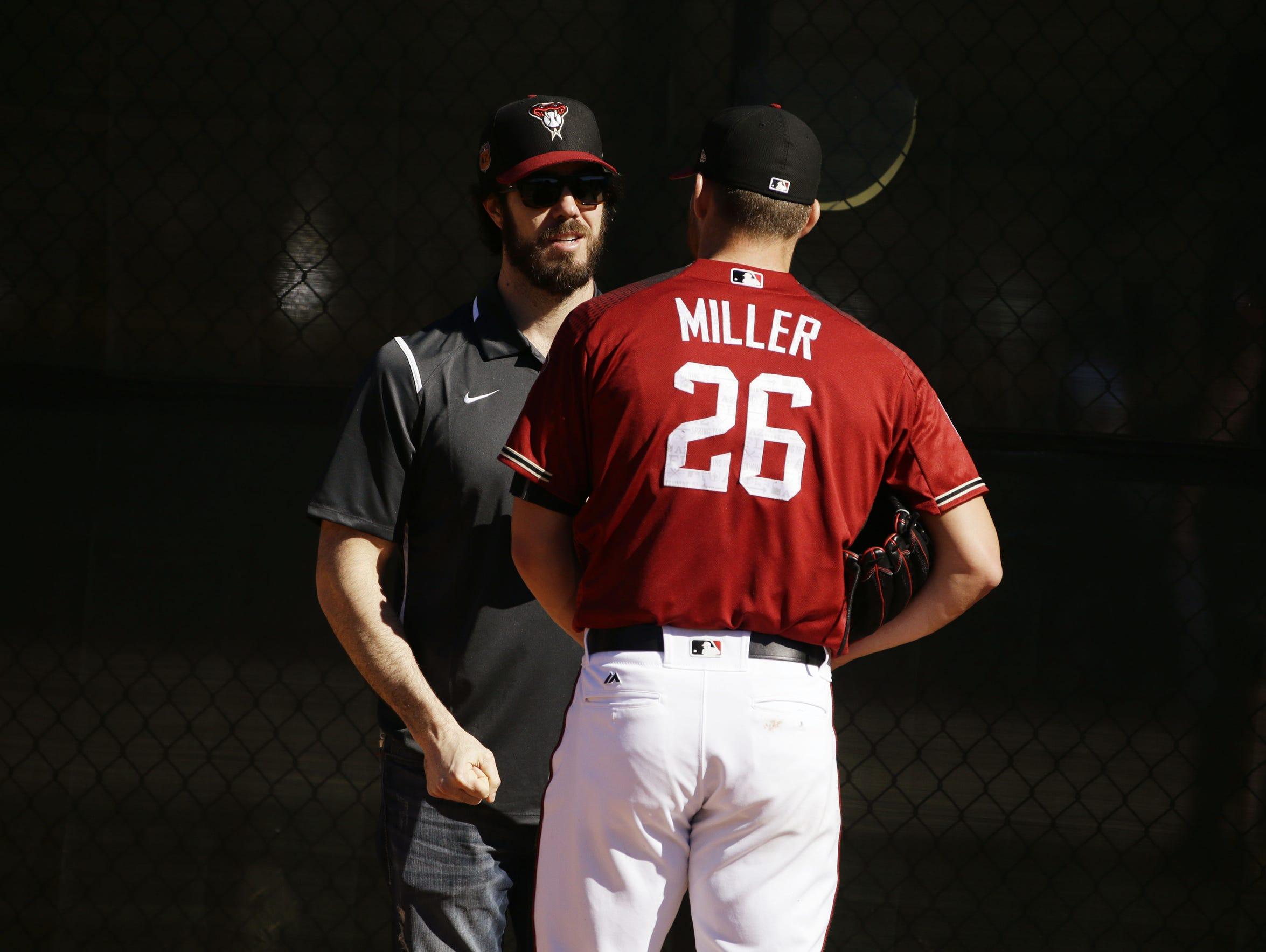 Diamondbacks starting pitcher Shelby Miller talks to