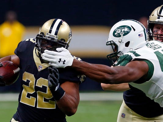 New Orleans Saints running back Mark Ingram (22) carries past New York Jets outside linebacker David Bass in the first half of an NFL football game in New Orleans, Sunday, Dec. 17, 2017. (AP Photo/Butch Dill)